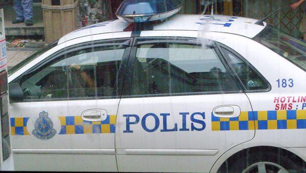 Машина полиции в Куала-Лумпур - Sputnik Узбекистан