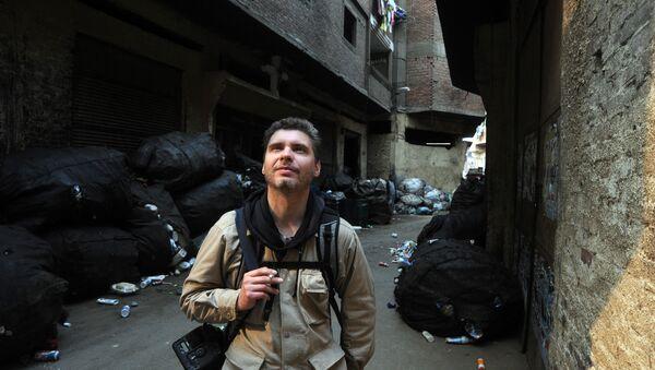 Фотокорреспондент МИА Россия сегодня Андрей Стенин - Sputnik Узбекистан