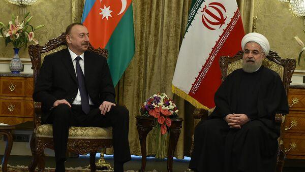 Встреча президента Азербайджанской Республики Ильхама Алиева и президента Исламской Республики Иран Хасана Роухани - Sputnik Узбекистан