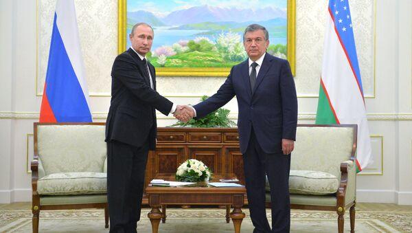 Rossiya prezidenti Vladimir Putin va Oʻzbekiston prezidenti Shavkat Mirziyoyev - Sputnik Oʻzbekiston