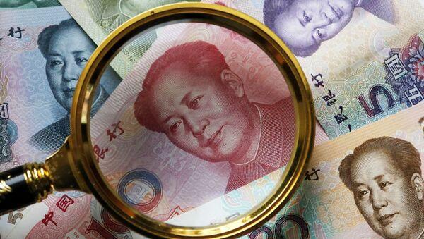 Китайские банкноты номиналом в 100, 50, 20,10 и 5 юаней - Sputnik Ўзбекистон