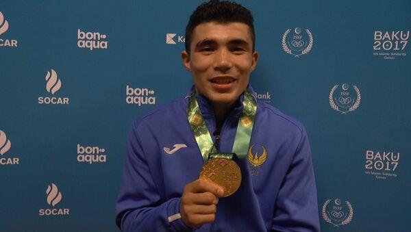 Узбекский боксер Шарахматов: свою золотую медаль дома надену маме - Sputnik Ўзбекистон