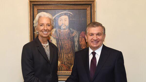 Президент Узбекистана Шавкат Мирзиёев и Кристин Лагард - Sputnik Узбекистан