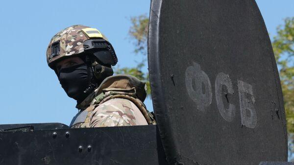Сотрудник подразделения спецназначения ФСБ России - Sputnik Узбекистан