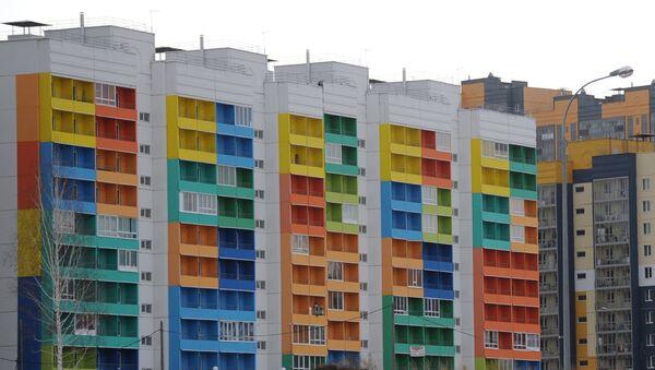 Многоэтажные дома с разноцветным фасадом - Sputnik Ўзбекистон