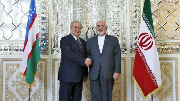 Министры иностранных дел Узбекистана и Ирана Абдулазиз Камилов и Джавад Зариф - Sputnik Узбекистан