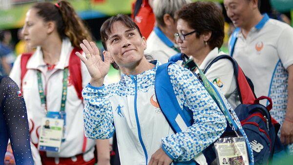 Oksana Chusovitina (Uzbekistan) vo vremya kvalifikatsionnыx sorevnovaniy po sportivnoy gimnastike na XXXI letnix Olimpiyskix igrax - Sputnik Oʻzbekiston