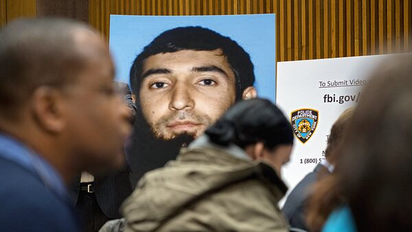 A photo of Sayfullo Saipov is displayed at a news conference at One Police Plaza Wednesday, Nov. 1, 2017, in New York. Saipov is accused of driving a truck on a bike path that killed several and injured others Tuesday near One World Trade Center. - Sputnik Ўзбекистон