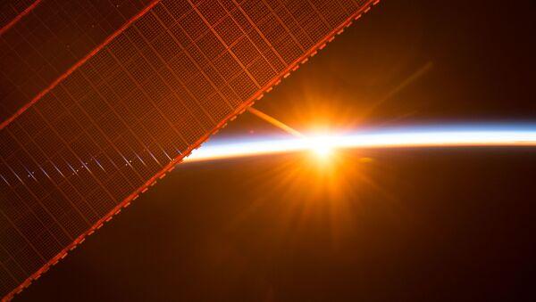 Вид на восход солнца с борта МКС - Sputnik Ўзбекистон