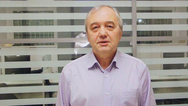 Виктор Марков, старший аналитик ИК Церих Кэпитал Менеджмент(фотография с экрана монитора) - Sputnik Ўзбекистон