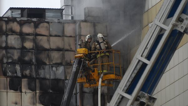 Пожар в торговом центре «Зимняя вишня» в Кемерово - Sputnik Ўзбекистон