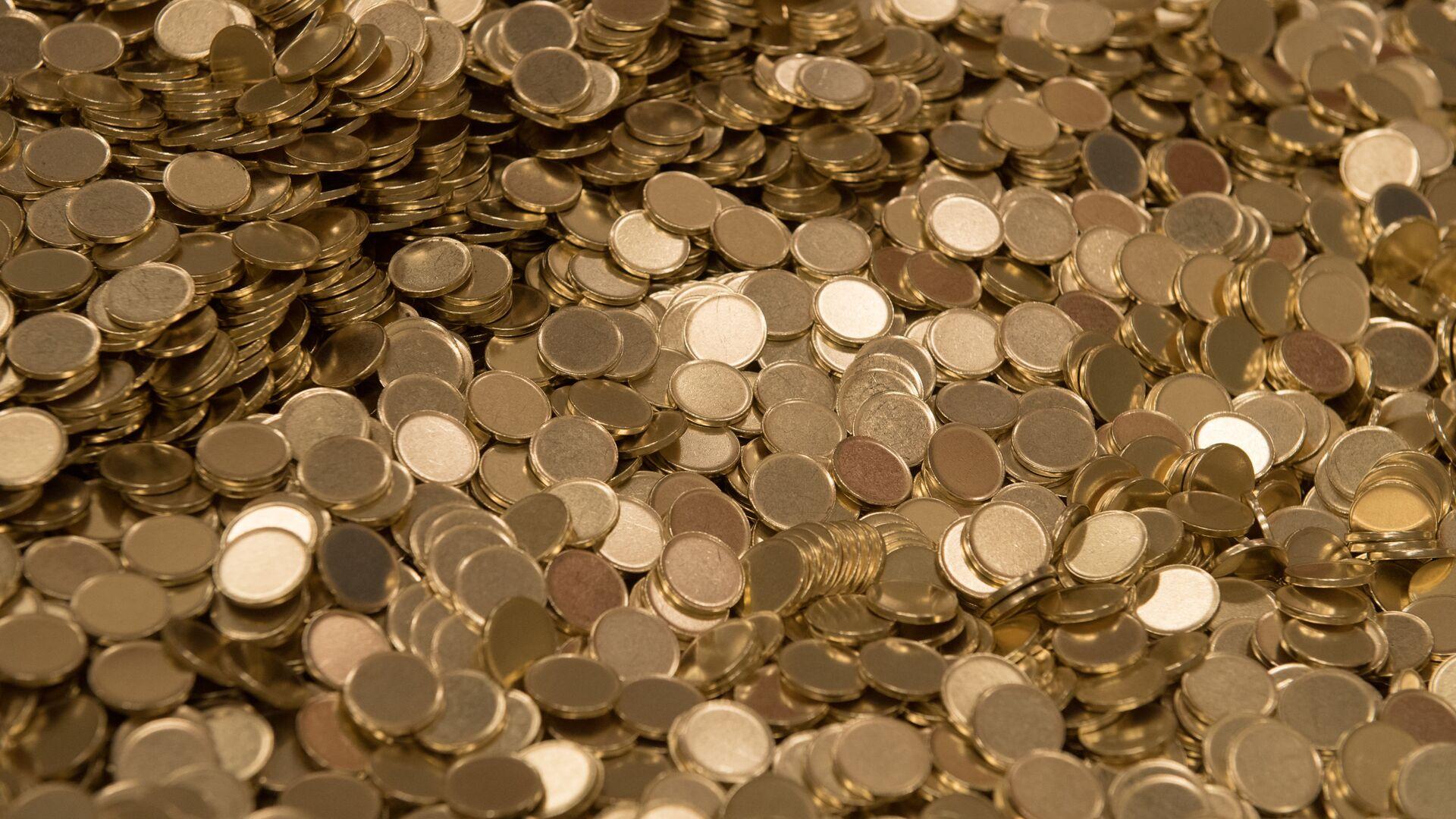 Заготовки для чеканки монет  - Sputnik Узбекистан, 1920, 21.09.2021
